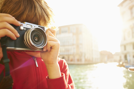 top 7: Young boy exploring with camera, Venice, Italy