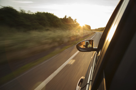 cumbria: Car driving along road,reflection in wing mirror LANG_EVOIMAGES