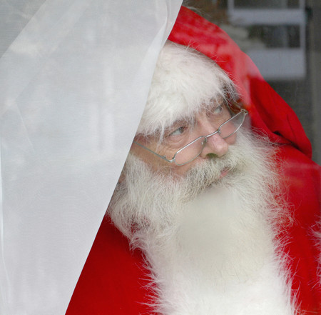 65 69 years: Santa Claus looking out of window LANG_EVOIMAGES