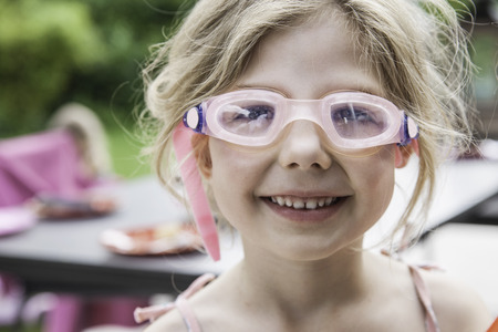 Girl wearing goggles LANG_EVOIMAGES