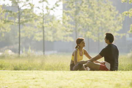 Couple sitting in park