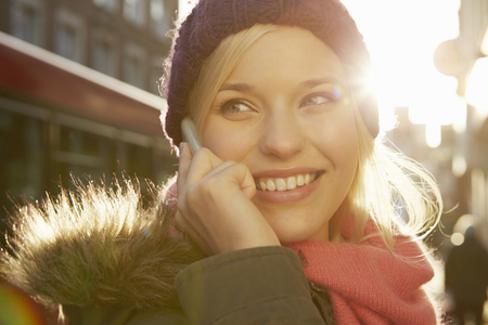 Portrait of young woman wearing knit hat,telephone call LANG_EVOIMAGES