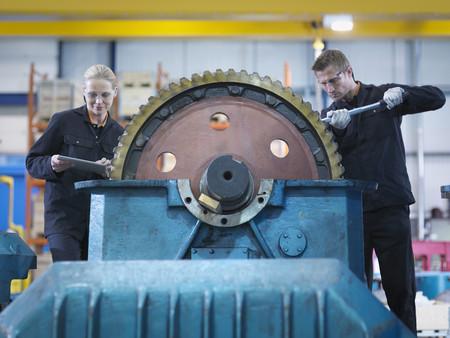 Engineers repair industrial gearbox in engineering factory LANG_EVOIMAGES