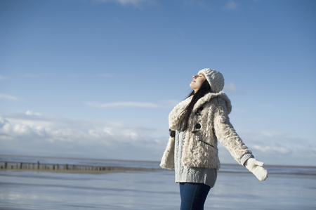 levantandose: Young woman with arms out,Brean Sands,Somerset,England