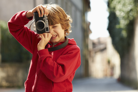 top 7: Young boy photographing on street, Province of Venice, Italy LANG_EVOIMAGES