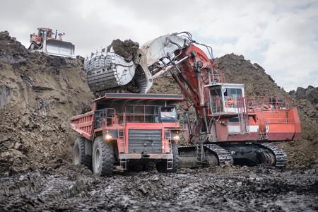 Large excavator and dumper truck in surface coal mine LANG_EVOIMAGES