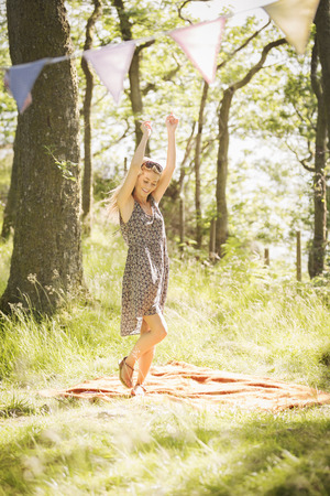 cumbria: Young woman dancing in forest LANG_EVOIMAGES