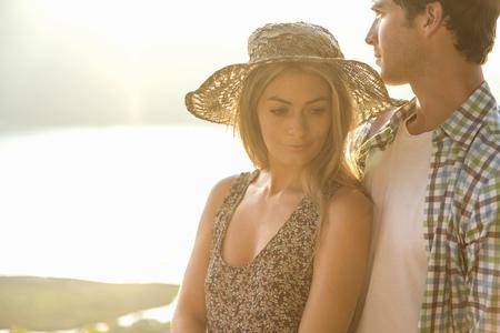 Young couple,woman wearing sunhat