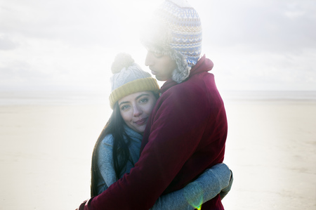 brean: Young couple hugging on beach