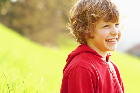 top 7: Young boy in grassy field