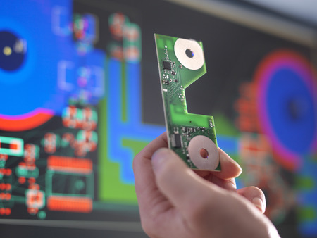 50 54 years: Close up of engineer holding electronic circuitry for automotive use