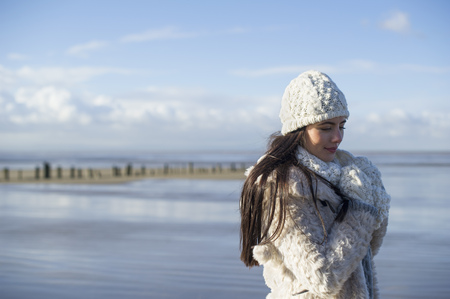 brean: Young woman wearing knit hat,Brean Sands,Somerset,England