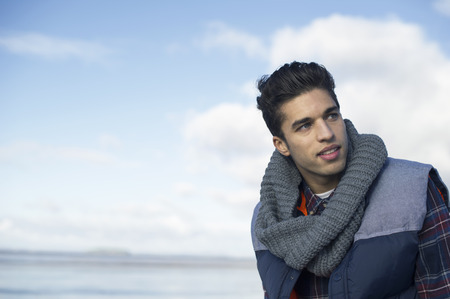 brean: Young man wearing grey scarf