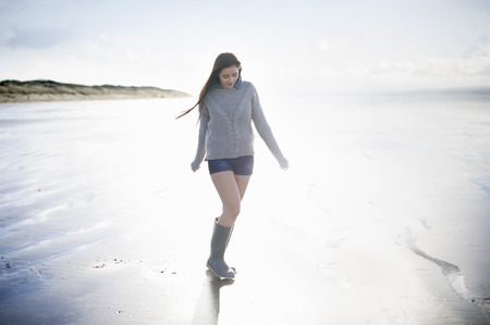 brean: Young woman on beach in sunlight,Brean Sands,Somerset,England LANG_EVOIMAGES