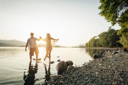 cumbria: Young couple paddling in lake,Cumbria,England,UK