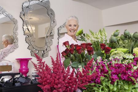 Senior woman in florist shop