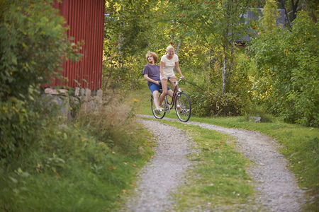 Young adult couple having fun on bicycle,Gavle,Sweden