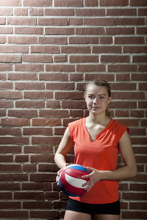 Volleyball player with ball LANG_EVOIMAGES