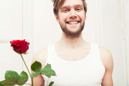 flirtation: Young man, holding red rose