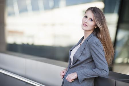 Portrait of businesswoman outside office building