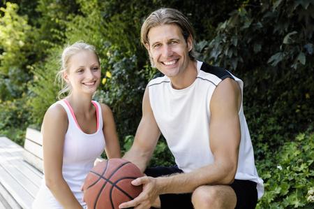 Portrait of basketball players taking a break in park