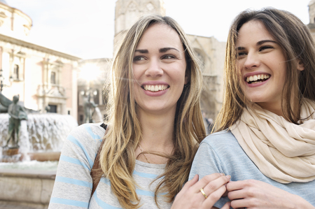 Two young female tourists, Plaza de la Virgen, Valencia, Spain