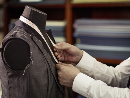 50 54 years: Tailor measuring garment in traditional tailors shop LANG_EVOIMAGES