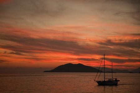 Silhouetted boat at sunset, Fethiye, Turkey