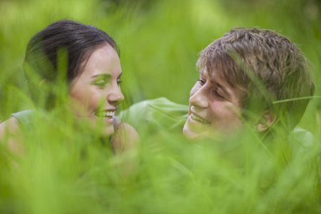 Young couple lying in long grass