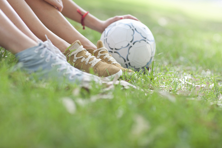 Cropped shot of young womens legs and soccer ball