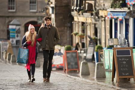 A young couple shop in the Grassmarket in Edinburgh, Scotland