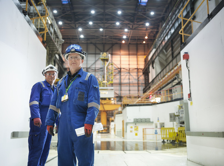 boiler suit: Portrait of engineers in reactor hall in nuclear power station LANG_EVOIMAGES