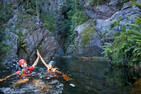 Man and woman canyoneering LANG_EVOIMAGES