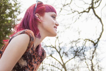 Portrait of smiling young woman with pink hair LANG_EVOIMAGES
