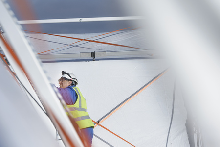 Emergency Response Team worker erecting tent control centre