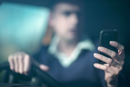 careless: Man using smartphone whilst driving