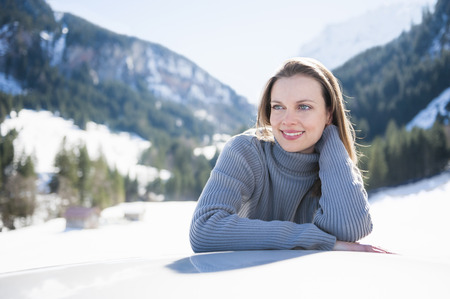 leaning against: Portrait of young woman leaning on car roof, Bludenz, Austria