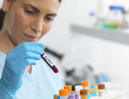 Scientist viewing various human samples for testing in the laboratory