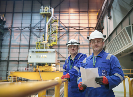 Portrait of engineers in reactor hall in nuclear power station LANG_EVOIMAGES
