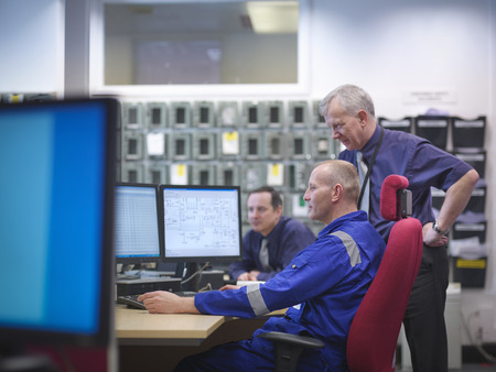 Engineers in meeting in nuclear power station