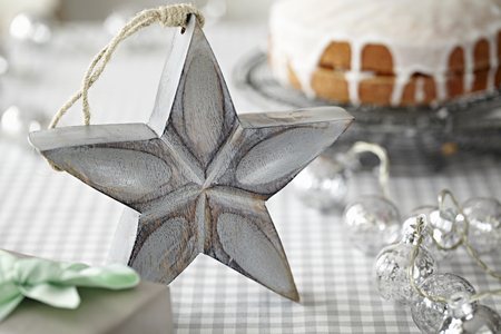 vintage: Star decoration in front of iced cake