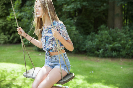 Teenage girl on swing