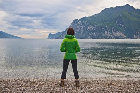 Woman looking out Lake Garda, Riva Del Garda, Trentino, Italy LANG_EVOIMAGES