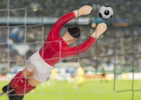 Digitally generated close up image of soccer goalkeeper in stadium LANG_EVOIMAGES
