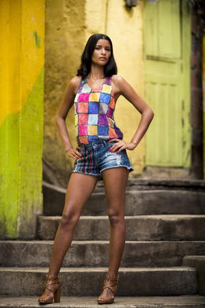 marta: Young woman posing on stairway, Favela Santa Marta, Rio de Janeiro Brazil LANG_EVOIMAGES