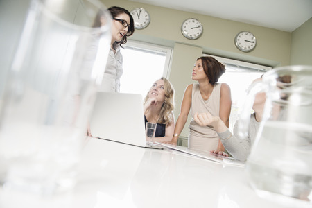 Four businesswomen meeting in conference room