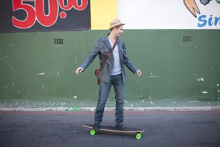 numeric: Mid adult male skateboarding on city street