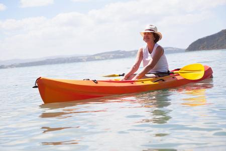 Senior woman sea kayaking LANG_EVOIMAGES