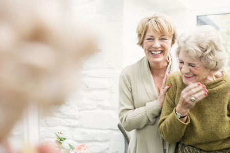 Senior woman with daughter, laughing LANG_EVOIMAGES