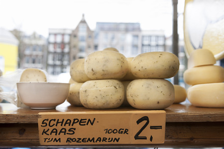 Round cheeses in shop window, Amsterdam, Netherlands